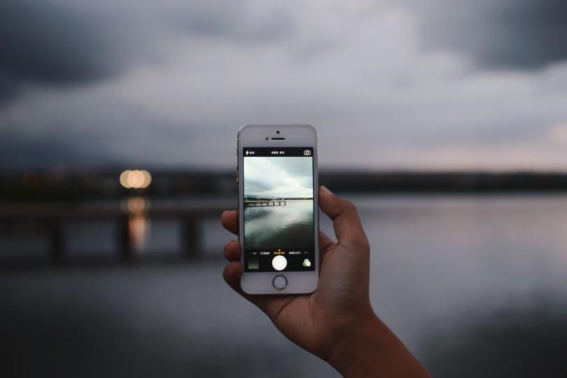 iPhone Taking Night Water Photo